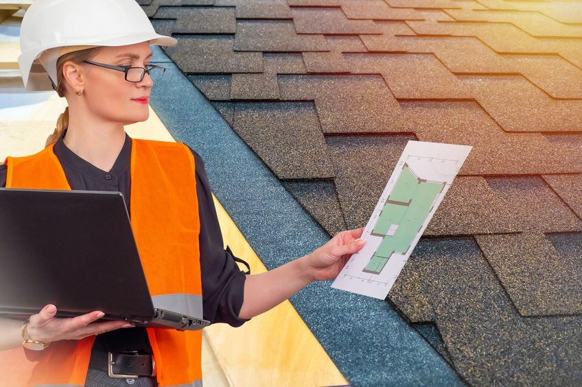 Woman looks drawings of building. Builder next to roof house. Bi